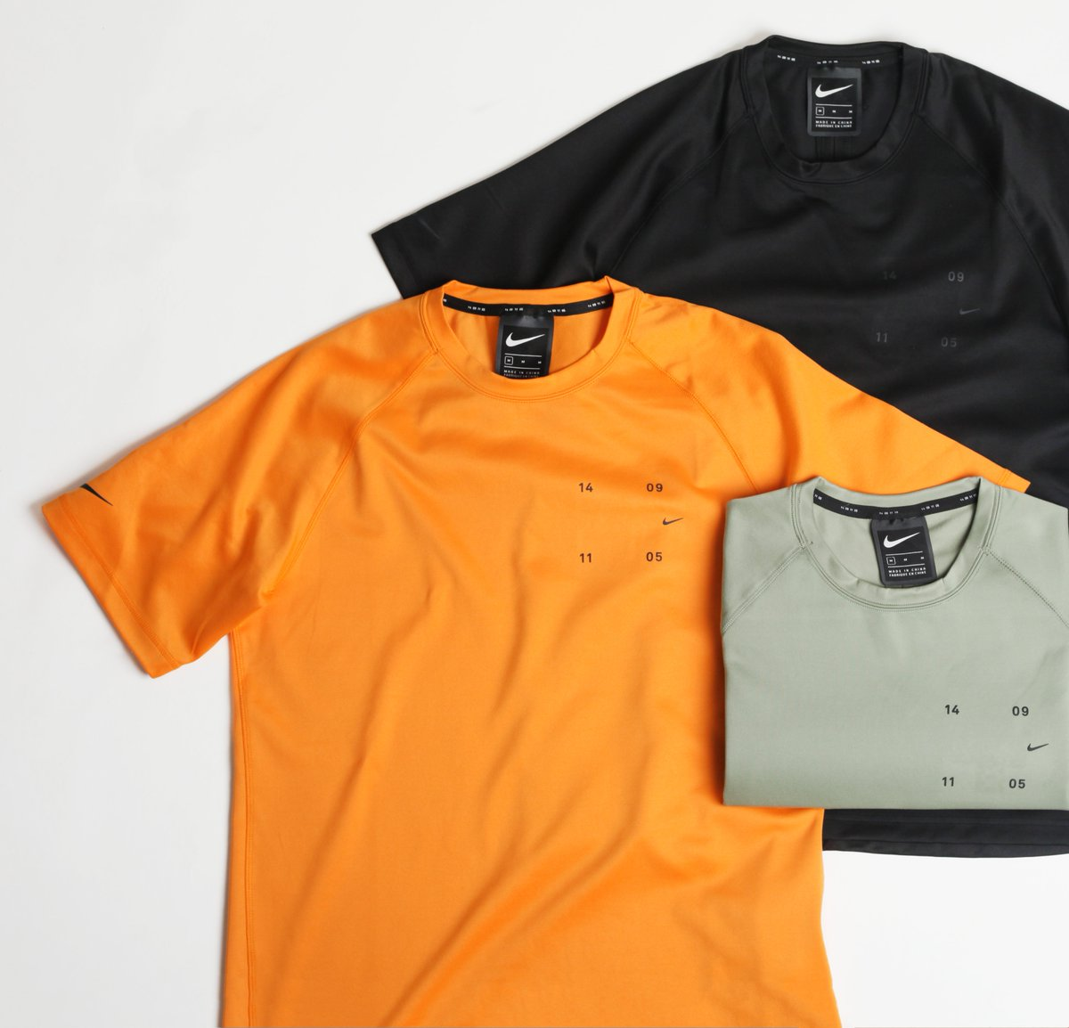 41ce0c16c691 Nike S/S Tech Pack Top in Kumquat, Jade Stone and Black are now ...