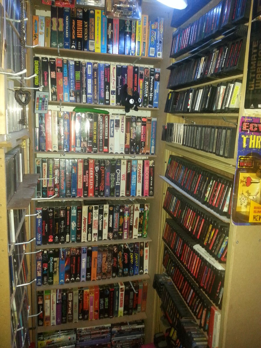 Over 2,000+ VHS tapes, 400+ DVDs, bout 8 Blu-rays. About 250+ Cassettes, 400+ CDs, 0 streaming services. No TV. 500+ NES games, 250+ SNES games, 150+ Genesis games, 0 PS4/XBone/Switch games.  This place is a cave of the 80s/90s. Picture == small sample. #SignsThatYouLiveInThePast