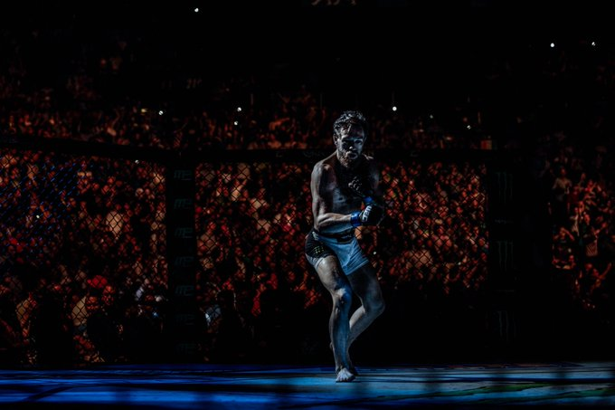 Four years ago today I photographed Conor McGregor (@TheNotoriousMMA) winning his first UFC title. This photo was taken during Mendes walkout as McGregor was moving around Octagon.   #UFC189   Photographing moments like this really make me feel like a part of history.
