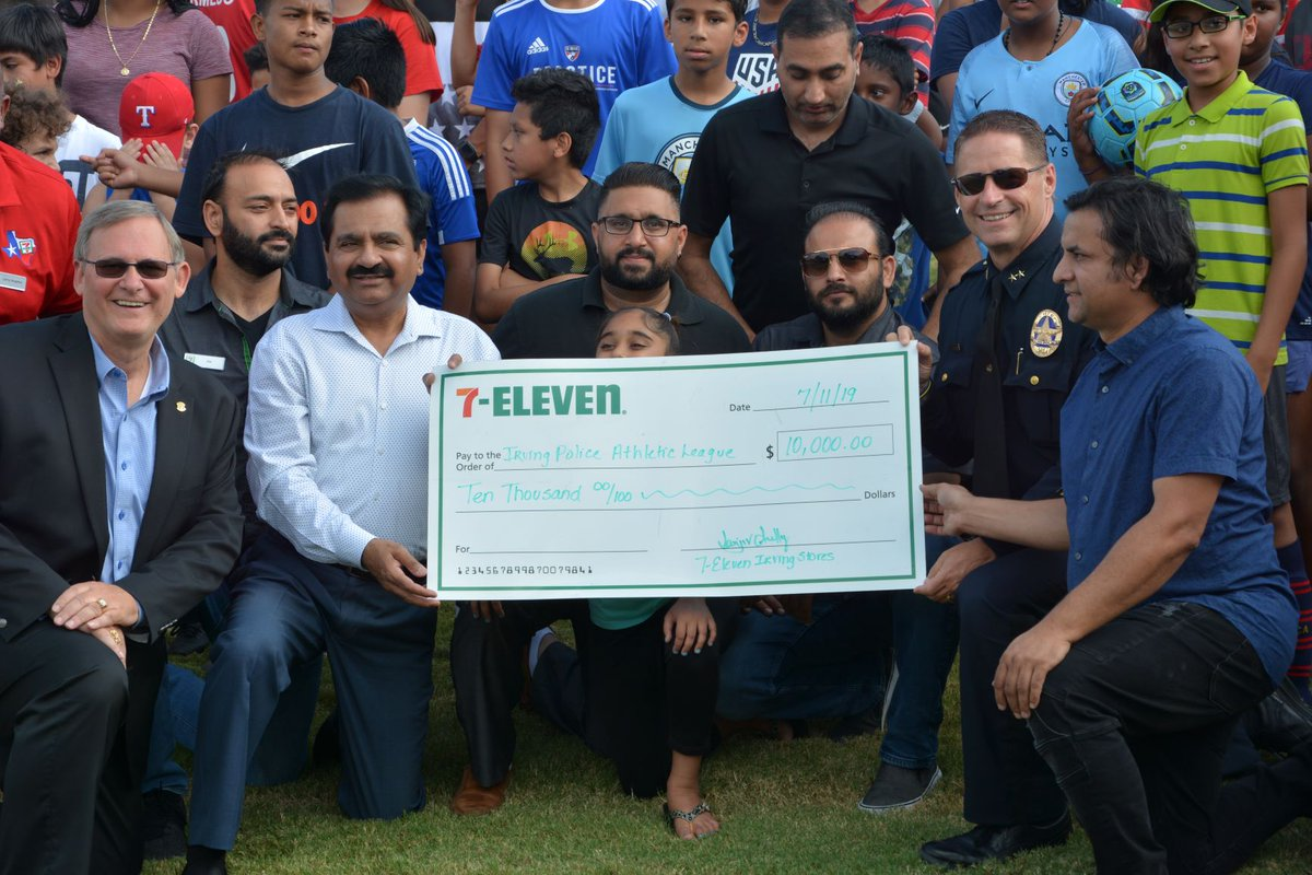 #7Eleven franchise owners presented a check to the Irving Police Athletic League #IrvingPAL