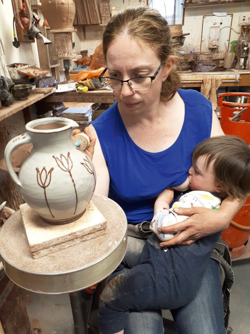 There's something heartwarming about Hannah decorating a pot whilst feeding a babe.  If you read Doug's Diary you'll know this is one busy pottery family. Hannah says it's a juggling act and she's not kidding...   The thing is, neither #babies nor #pots like being dropped!