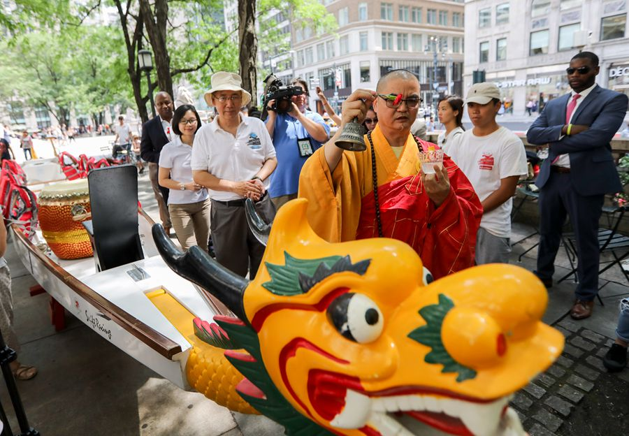 """Enter the Dragon! They paint the eyes of the dragon to """"awaken"""" it!This is all a prelude to a dragon boat racing festival in #NewYorkCity in August http://xhne.ws/aBUrA"""