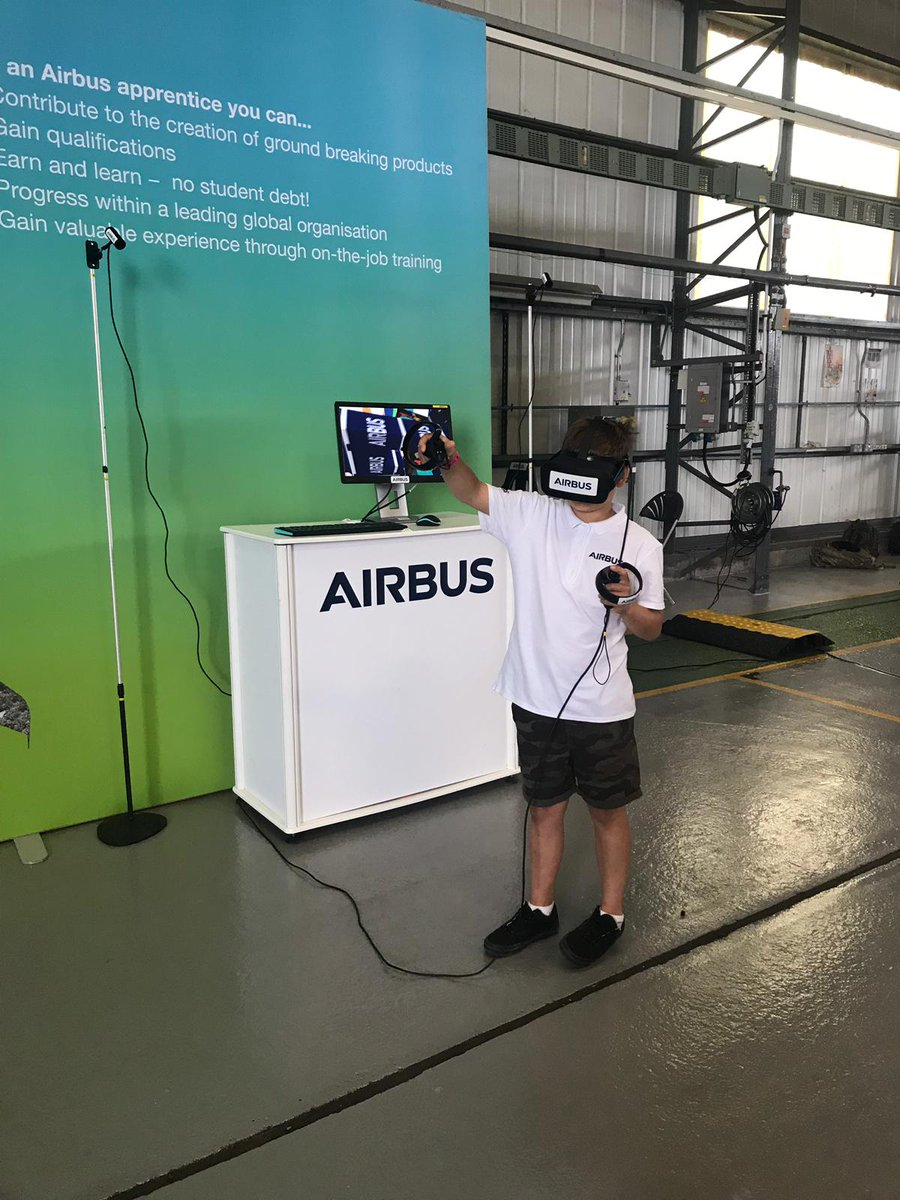 Our education liaison team spent the day at the @YeoviltonAirDay today talking to people about the wonderful world of @AirbusintheUK. Here's one of the youngest team members trialling the #HoloLens #STEM #inspirethenext #wemakeitfly @AirbusCareers