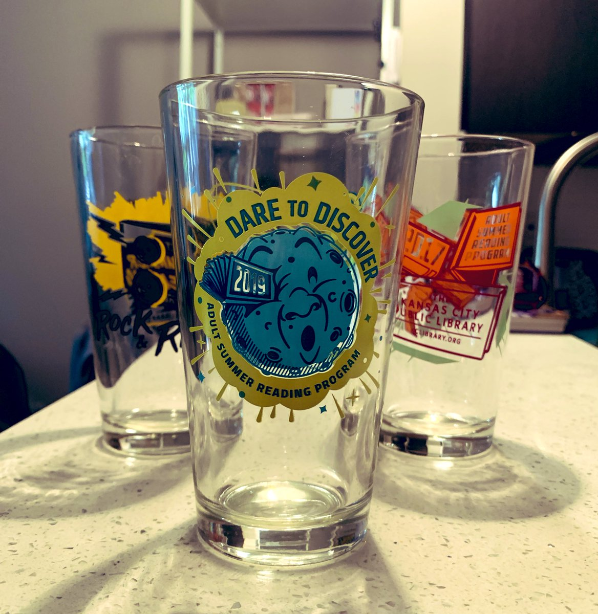 Added this year's pint glass to the collection! Thank you @KCLibrary for the awesome Summer Readung Program! I look forward to it every summer. #kcsummerreads <br>http://pic.twitter.com/KvGq6VihzV