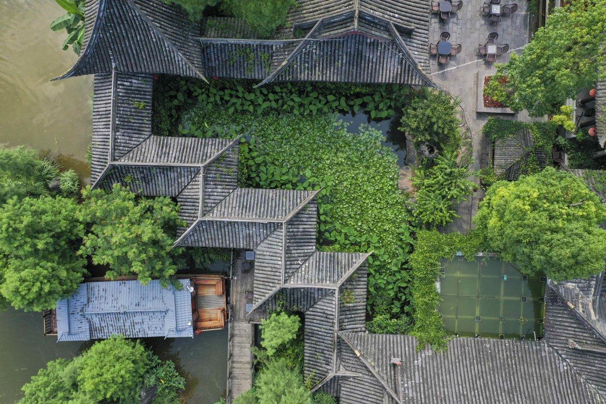 Canals, stone bridges, pagodas, and meticulously designed gardens have made Xiuhu National Wetland Park a popular tourist destination, southwest China's Chongqing #FlyOverChina #EcoChina