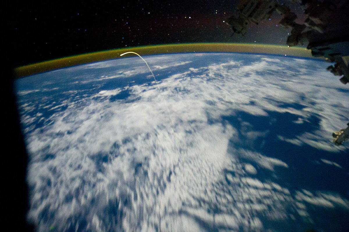 8 Years ago today....@astro_aggie takes amazing photo from #ISS of #STS135 re-entering the atmosphere. Shuttle, the bright spot at the top of the arc, leaves behind a trail of ionized gas.<br>http://pic.twitter.com/RI39ll5WLI