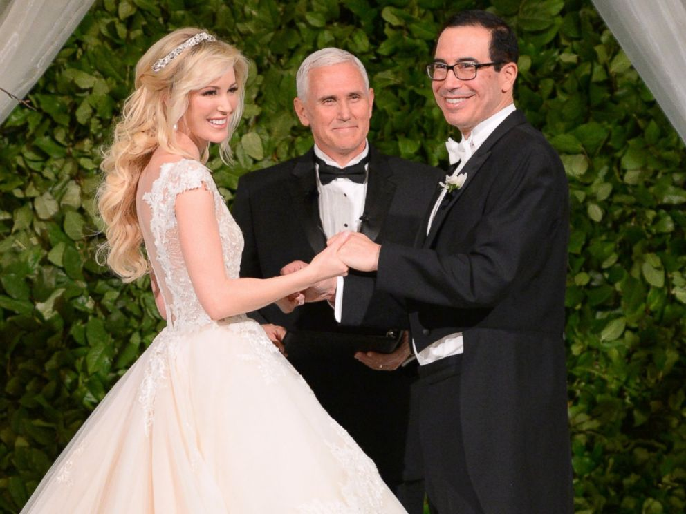"Louise Linton and Steve Mnuchin were married by Mike Pence, who said, ""While this is Steve's 3rd marriage and Louise's 2nd, I know that their mutual greed will bind them in evangelical love. Please don't kiss."" The marriage became the inspiration for the Saw movie franchise"