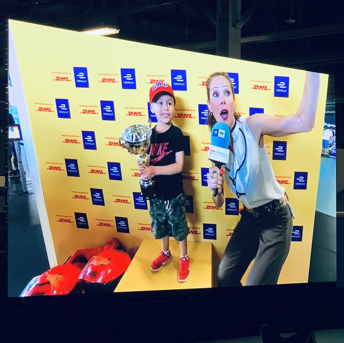Okay, no, this little boy didn't win the @FIAFormulaE Championship, @JeanEricVergne did! 🏆 And what a thrill it was to announce him to the podium for the second year in a row! 🎉 🎉MANY CONGRATS TO YOU and THE TEAM!! 🎉 #NYCePrix @DSTECHEETAH 🏆@DHL_Motorsports 🏎