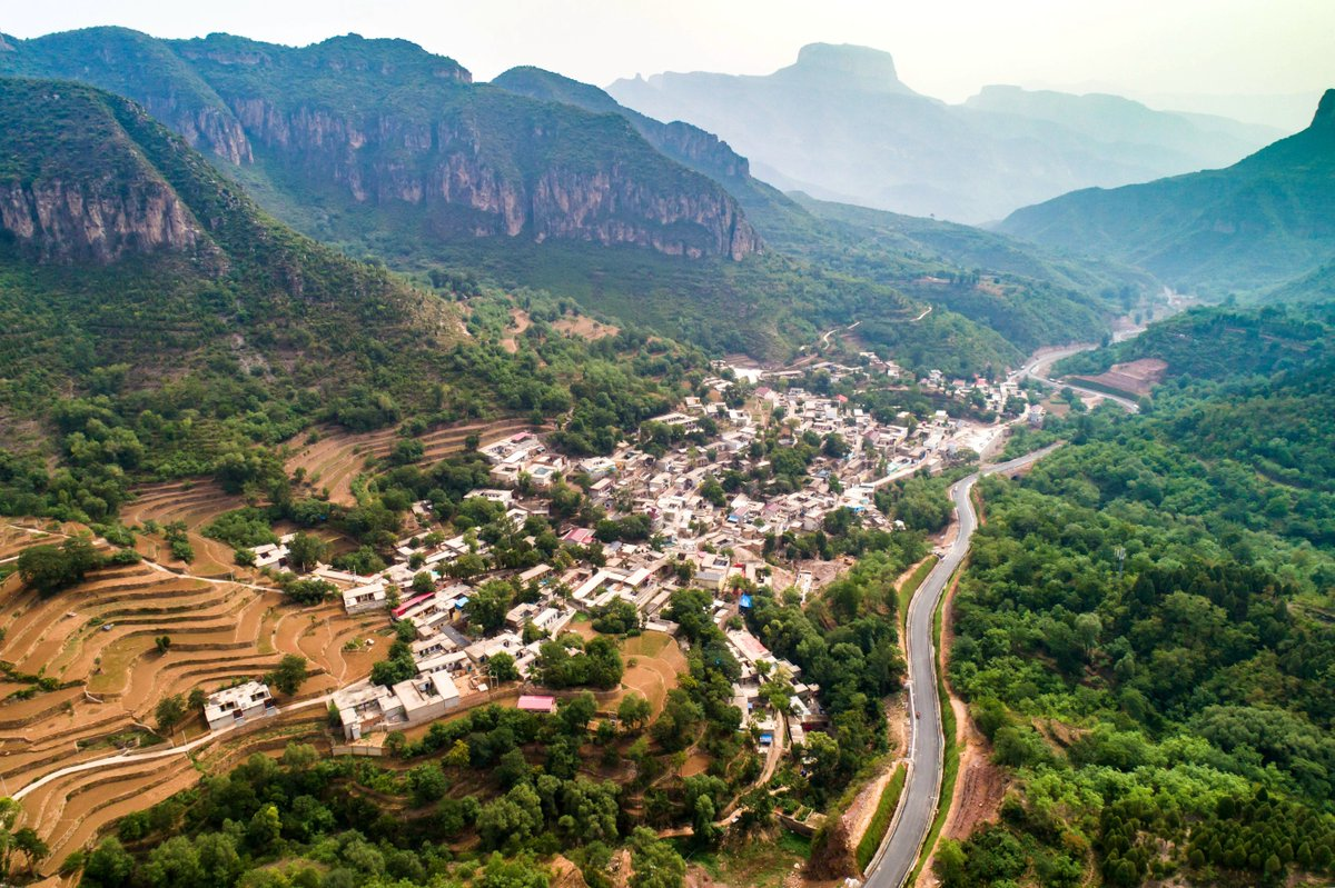 Chinese efforts on rural development - view the winding Baiyun highway across mountains in Wu'an City, N China's Heibei Province #FlyOverChina