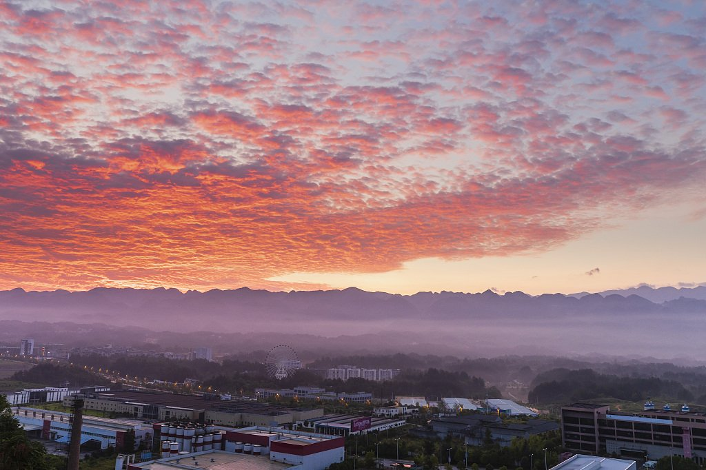 A rosy sunrise glow greets residents in central China's Chongqing