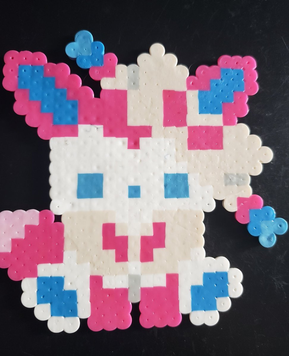 Good afternoon and happy Monday!!!!! Today we have a pretty #Sylveon! This is the last of our tiny baby #eeveelutions that we have now!!!! #pokemon #pokemongo  #gottacatchthemall #gottacatchthemallpokemon #eeveelutionsylveon #fairytypepokemon  #perlerbeadart #pixelart #perlerart