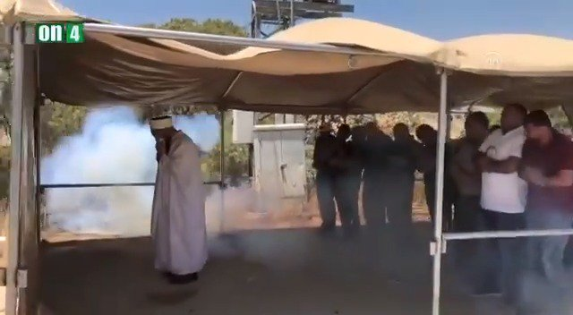 Israeli forces fired tear gas towards some Palestinians who were praying in a tent. This is beyond outrageous. This video is the very proof of #IsraeliCrimes against the Palestinians. @PalestinePR @santafeez