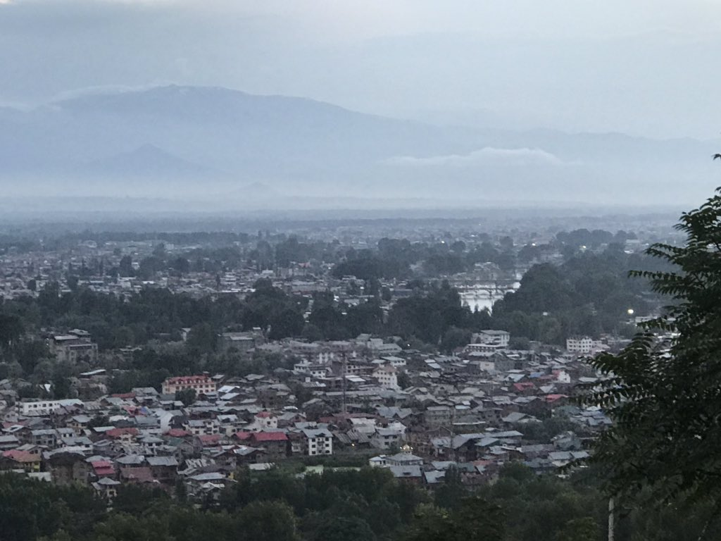 """As I exit the airport, my phone rings.  """"Pahunch gaye jenaab?"""" asks my friend from downtown.   Don't ask me how he knew. Here, everyone knows everything.  View of Srinagar from BB Cantt. <br>http://pic.twitter.com/rWGjlHE8ax"""