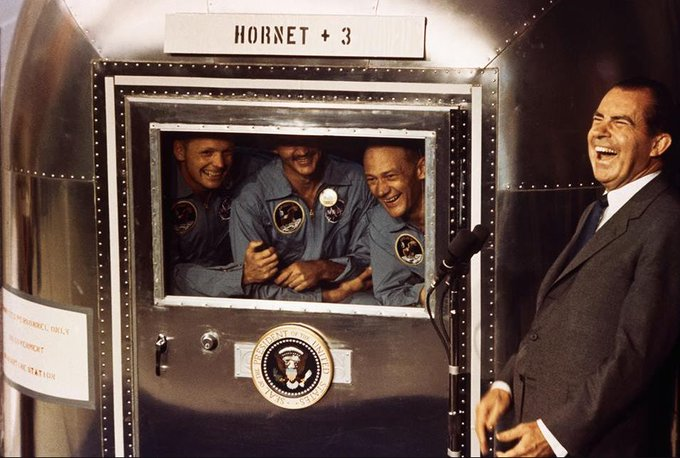 Nixon laughing with the Apollo 11 crew in the Mobile Quarantine Facility