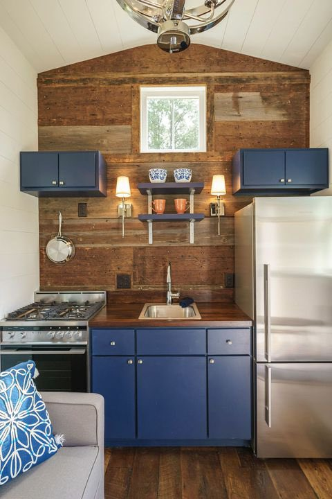 Instead of going light and airy, the Indigo Tiny Home by Driftwood Homes USA is decorated with pops of dark, moody colors.  #tinyhome #tinyhouse #tinyhousemovement #vanlife #tinyhouseonwheels #tinyhousenation