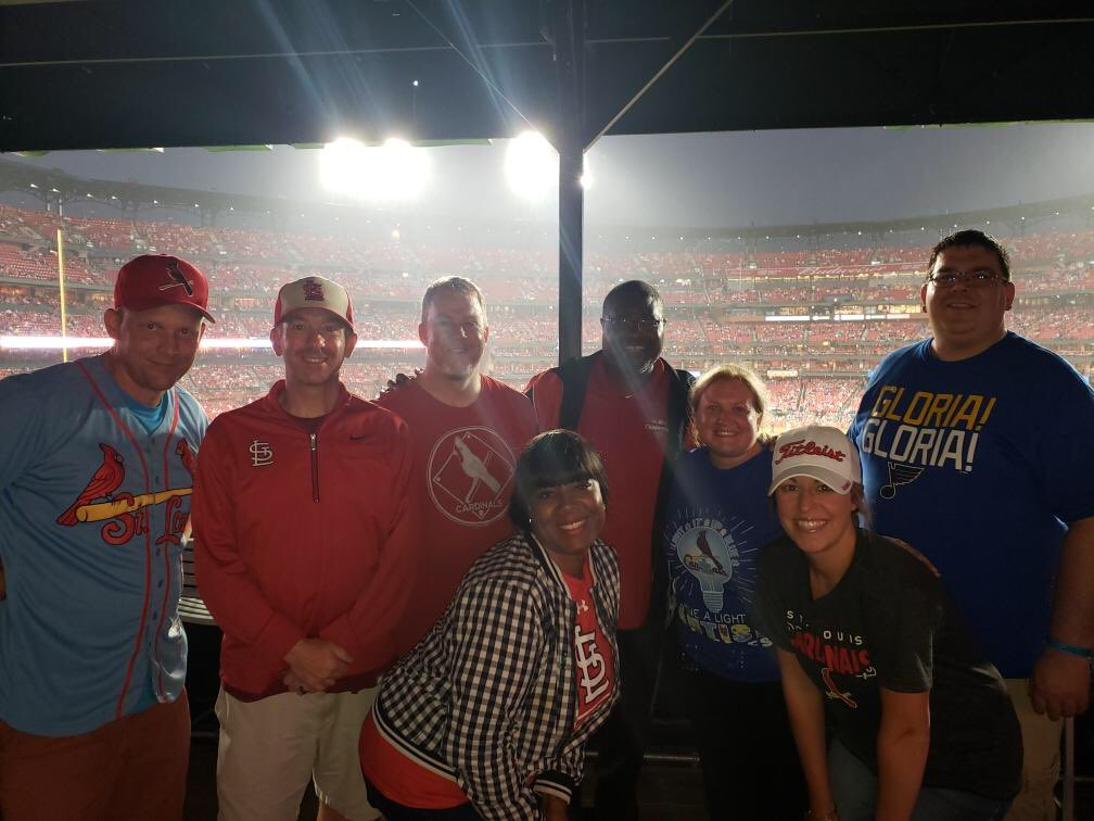 A little rain can't keep the MHS Admin team from helping the Cardinals get a win. #happysummer