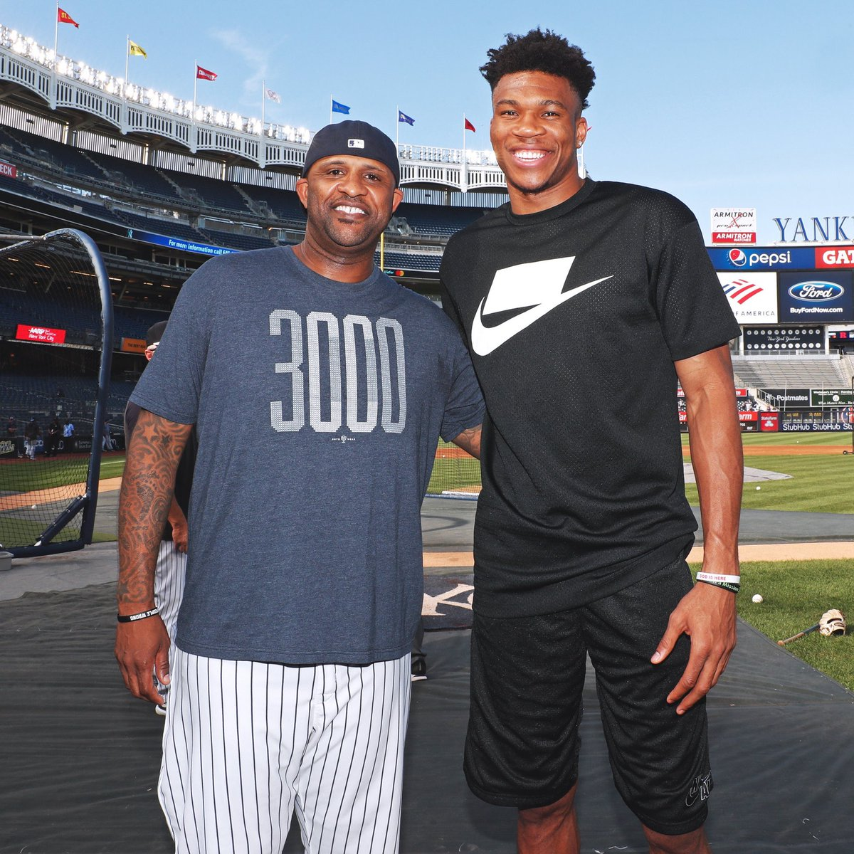 NBA players go back home and take pics with their AAU coach