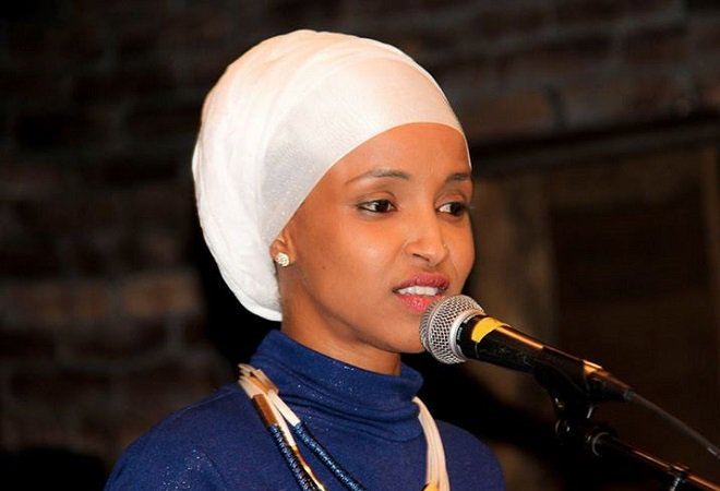 """Help me out! What is @IlhanMN Ilhan Omar wearing on her head?  My guess is that she is wearing her brother's (or is it husband's? )""""Fruit of the Looms"""" on her head. 😆Am I right?"""
