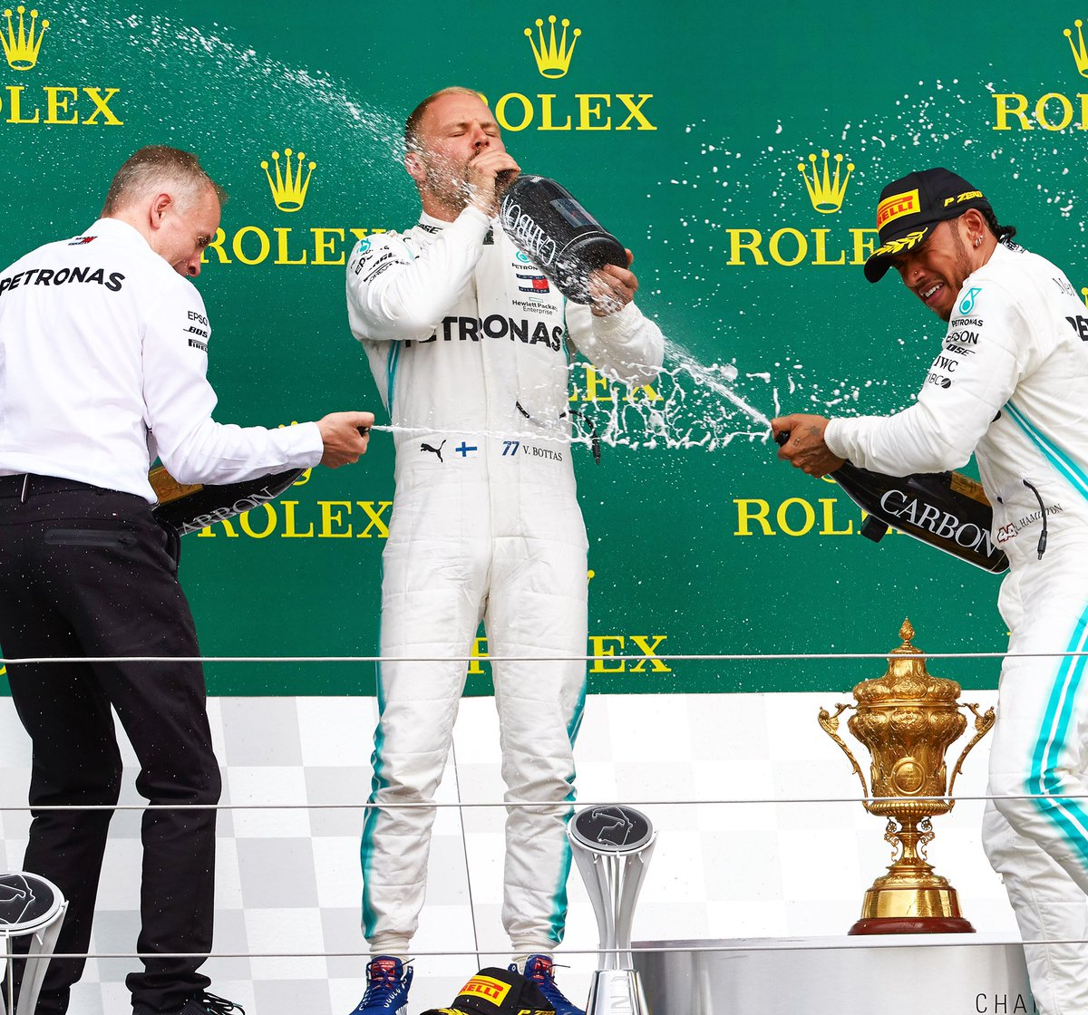 Spot the Finn 😂🍾   That's nine podiums in 2019 for @ValtteriBottas!  His best ever start to an @F1 season 💪