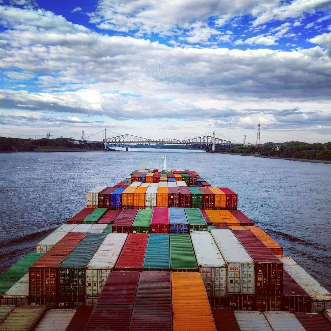 Montreal Express passing Quebec bridge, Canada #lifeatsea#marineinsight#sea#ship #seafarer#maritime#seaman#sailor#sailing  Photograph by Tushar Budke