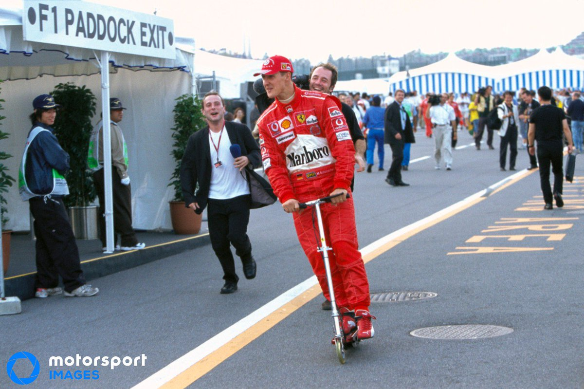 After seeing the abundance of snaps of drivers on scooters from this weekend's #BritishGP we'd like to point out Michael Schumacher was scooting through the paddock before Lewis Hamilton made it cool. 😜
