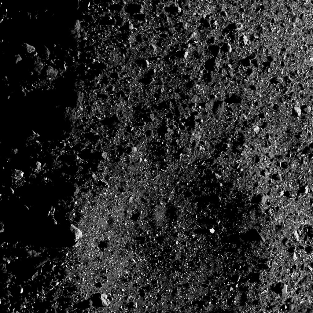 By request! Here's a different perspective of that crater within a crater in Bennu's south. It was taken while in a terminator orbit... you can see the line of dawn on the left. The shadows here provide a good sense of the larger crater's depth and size. bit.ly/2JDc6Mc