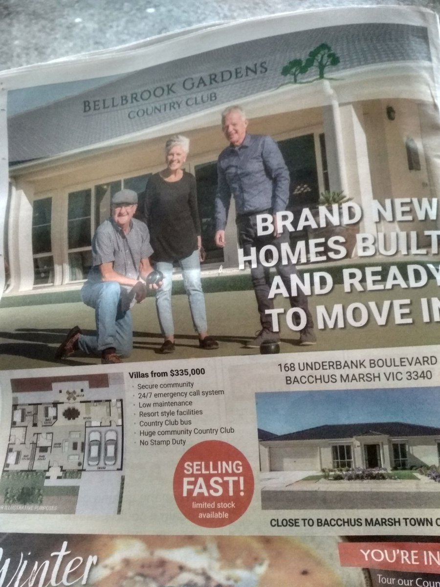 The ad at the back is also hilarious. You get 2 car spaces! And it's a #secure community because you're frightened of crime after reading the #HeraldSun. Bellbrook even has a 'country club bus' despite being far from useful public transport. #bacchusmarsh
