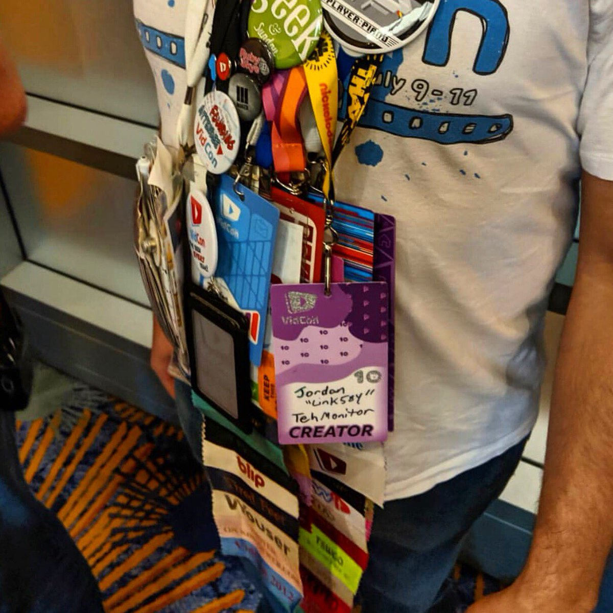 Every VidCon badge, as worn by an attendee who has been to every VidCon! via @hankgreen