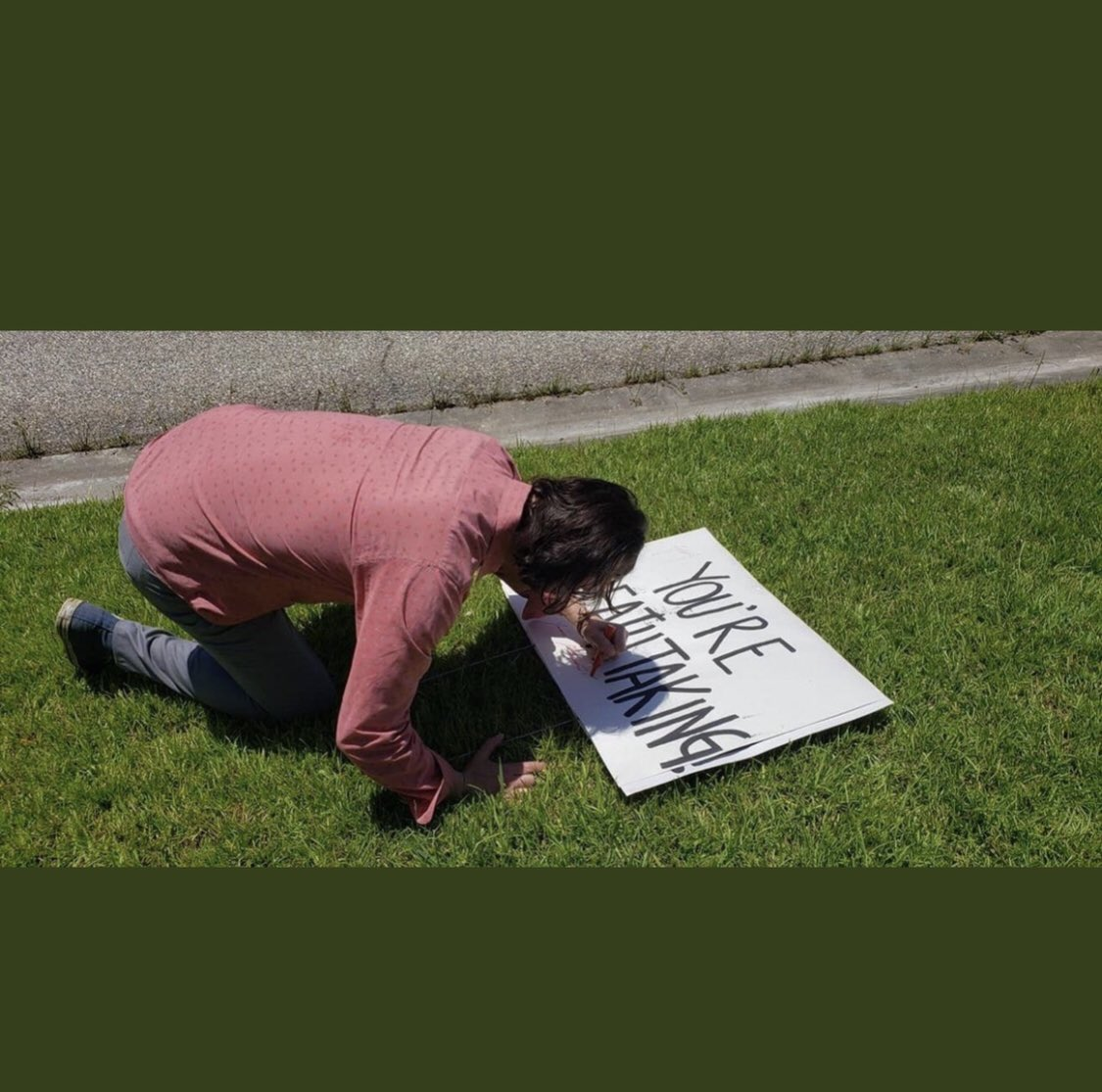So yesterday this sign was out on a lawn on the way to set. Keanu jumped out of the car and did this.