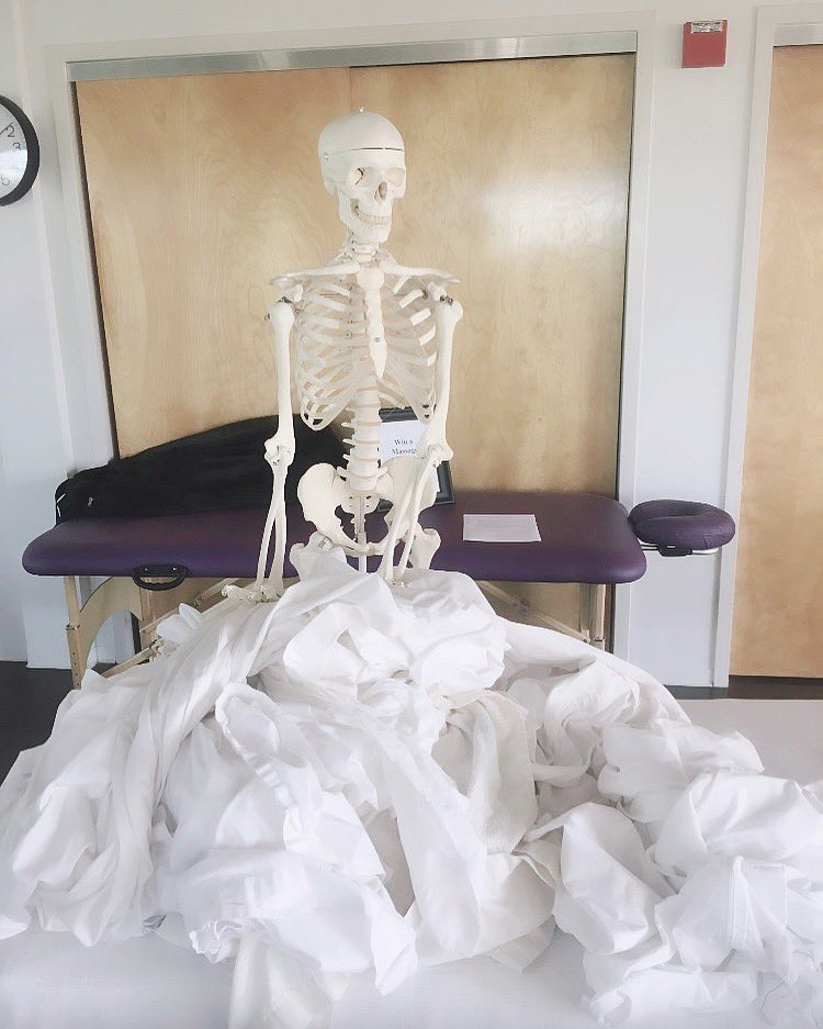 """#Skelly doing his part with the laundry. There's no """"I"""" in team! 💀⠀⠀⠀⠀ #massagetherapy #massage #spa #massagetherapist #wellness #relax #health #relaxation #love #school #therapy #beauty #sportsmassage #skincare #deeptissuemassage  #body #swedishmassage #elizabethgradyschool"""