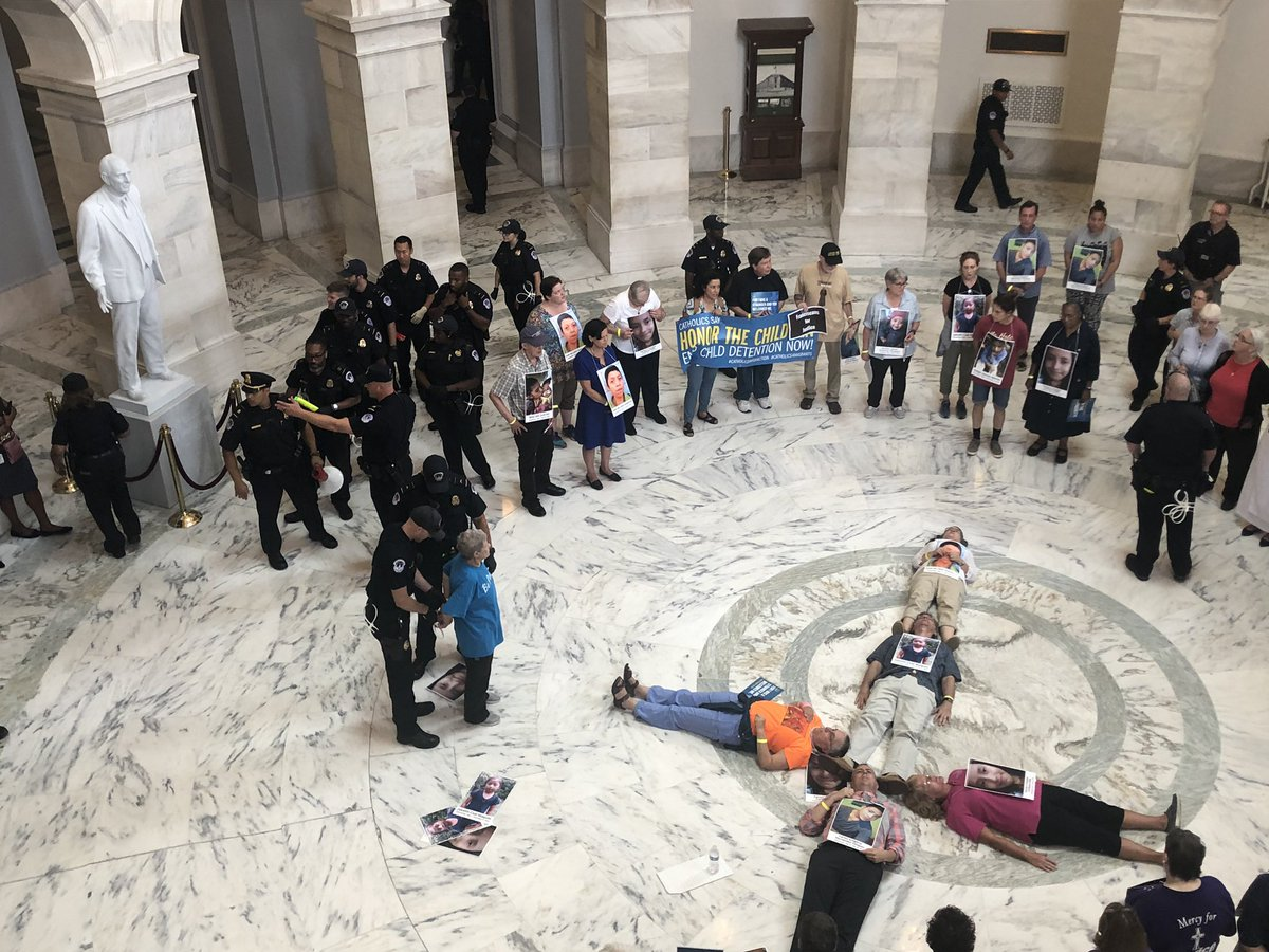 Police are arresting these nuns one by one, as they recite the Lord's Prayer, which is echoing off the marble walls of the Russell Rotunda here in #DC. About 50 senators have offices in this building. #CatholicDayOfAction