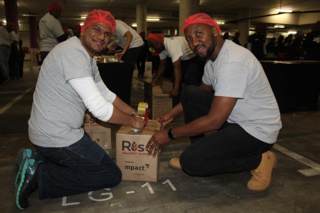 VIDEO: Rise for hunger creates unity this #MandelaDay  The initiative, held at Sun Arena's Time Square, saw hundreds of people join hands to package food for underprivileged children. Read more here: https://tinyurl.com/yywkmhq3   #MandelaDay2019 #Mandela100