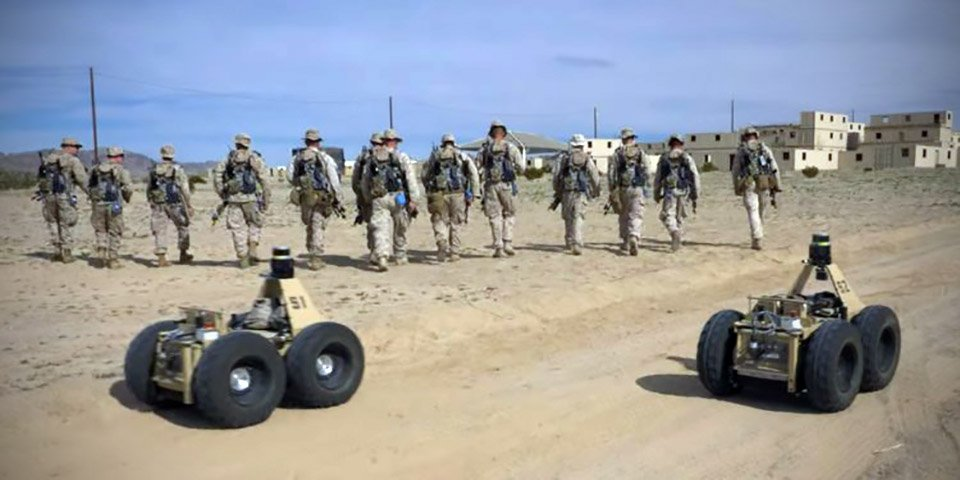 DARPA's Squad X experimentation program combines AI-powered #robots with real soldiers. https://www.techeblog.com/darpa-squad-x-ai-robots-marines-soldiers/ … #military #technology #robotics #marines
