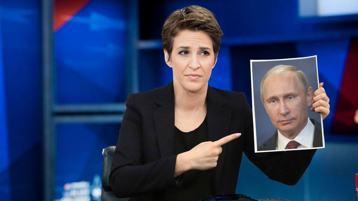 Взбешенная ведущая всю передачу тыкала в портрет Путина