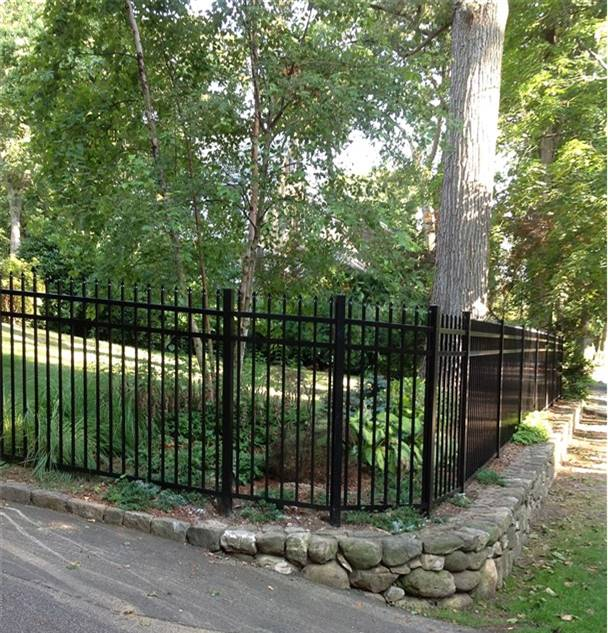 But Stone Walls And Aluminum Fences Go Together Like Peas Carrots Arrowfencecoinc Woodfence Cedarfence Pergola Archway Lattice Custate
