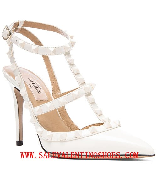 e3e8f580d472 Signature Valentino Rockstuds adorn three matte leather buckle straps up  ankle. Patent leather pointed toe. Padded leather insole  leather ...