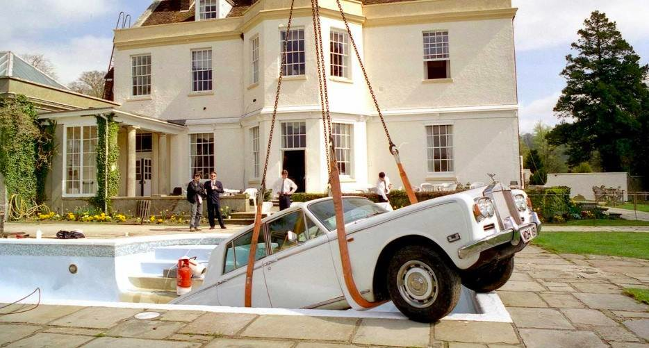 """""""Bonehead had mentioned the tale of Keith Moon driving his Rolls Royce into a swimming pool & that's where the concept began... People think it's a Photoshop job but we actually put the Roller in the pool. It was from a scrapyard and the back end was smashed in."""" (Brian Cannon)"""
