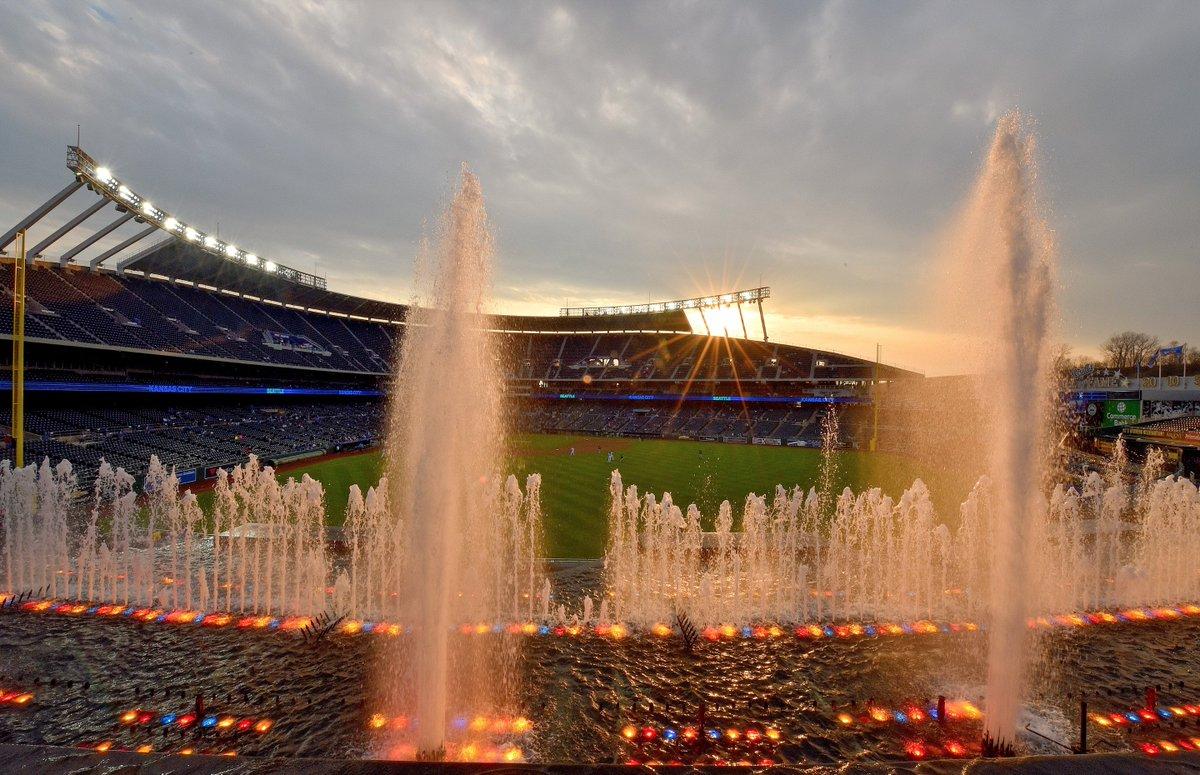 The setting sun behind Kauffman Stadium...