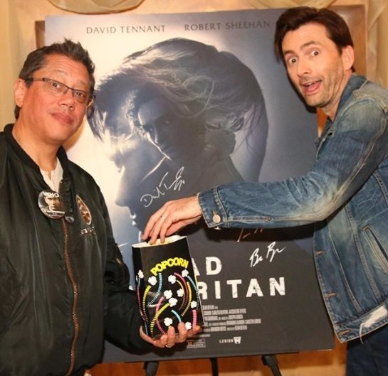 Dean Devlin and David Tennant in front of a Bad Samaritan poster at Silicon Valley Comic Con