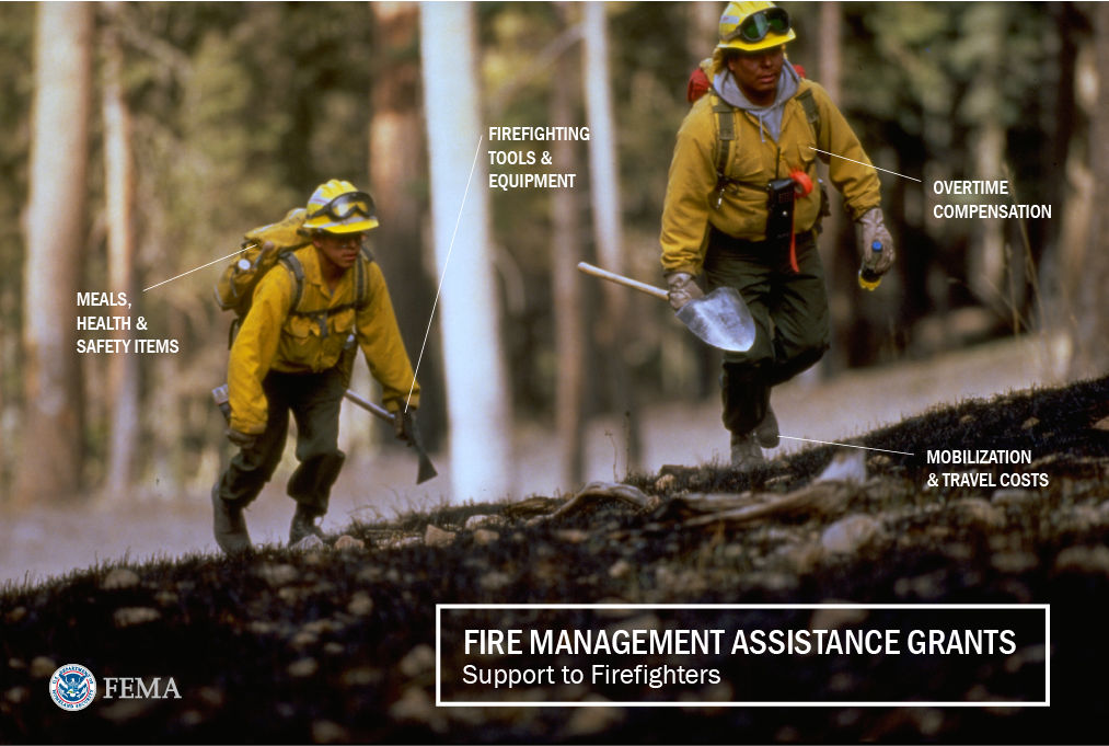 "Two New Mexico firefighters walk up a hill to continue battling smoldering forest fires. Labels point to the types of costs Fire Management Assistance Grants can cover to support firefighters. Text overlay reads: ""Fire Management Assistance Grants, Support to firefighters. • Firefighting tools and equipment • Overtime compensation • Mobilization and travel costs • Meals, health and safety items."""