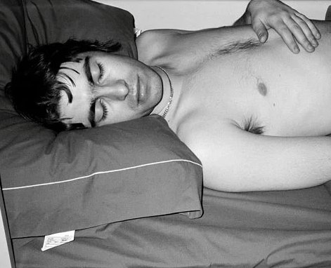 """March 96, USA: I was travelling with Oasis in America and had a berth on the tour bus opposite Liam.  One night I woke up to see him sleeping peacefully without a shirt on… I reached for the quick-shoot camera with flash praying he wouldnt wake up.""""  📸/Words: Jill Furmanovsky"""