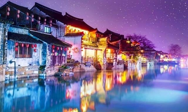 Take a two-hour bus ride from Shanghai to experience the stunning water town of Xitang!