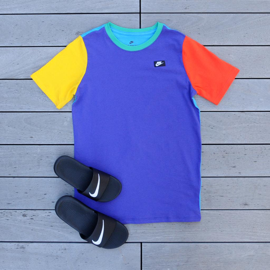 fbc92844d A look at the new Fusion Violet  Nike Colorblock 90 s Tee and Kawa Slides.  In stores and online now! Tee   http   bit.ly 2FlA2ja Slides   ...