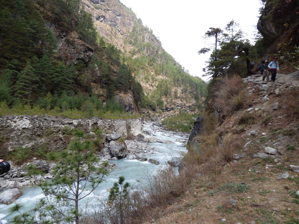 This day last year we trekked from the village of Monjo to Namche Bazaar (3500m). Walking over massive bridges and through spectacular scenery. Namche defies gravity, hanging onto the mountain-side. #Nepal @JaggedGlobe<br>http://pic.twitter.com/jqWhQvJn8o