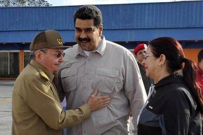 Nicolás Maduro's photo on Raúl Castro