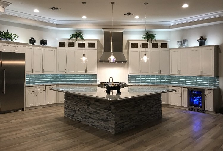 These beautiful silver glass tiles throw off a blue hue with under cabinet lighting want to put a unique touch in your kitchen