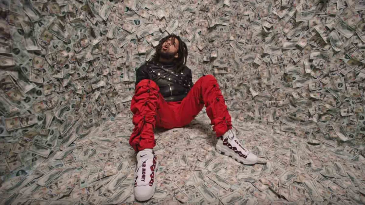 bb8d322639c5 jcolenc wears nike air more money in atm video .