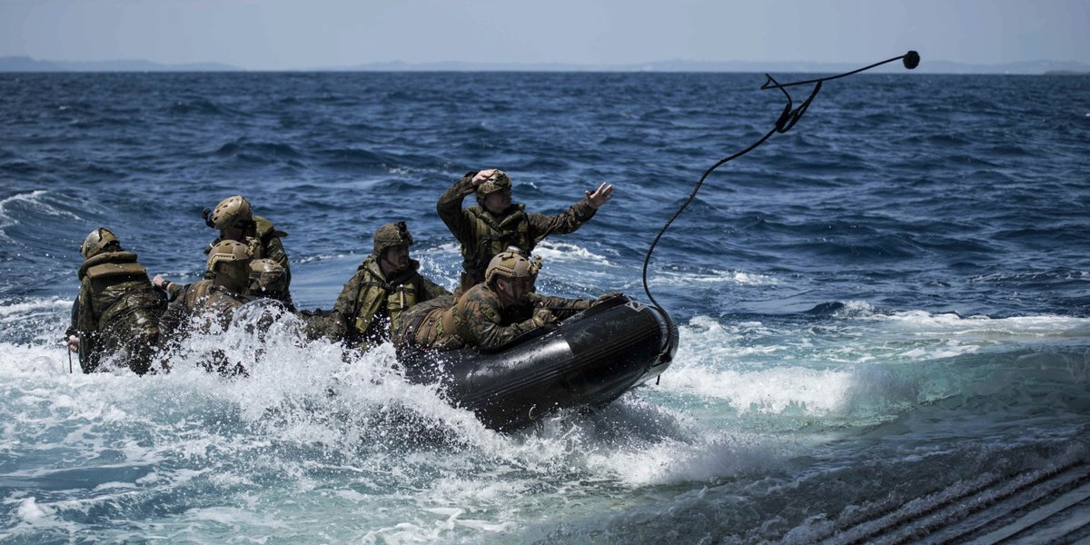 Throw it Home  Marines conduct boat raid recovery in a combat rubber raiding craft in the Philippine Sea.