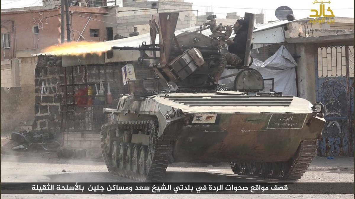 BMP-1 with a ZPU-2 AA gun mounted on top, in use with Jaish Khalid Ibn al-Walid in their Daraa enclave
