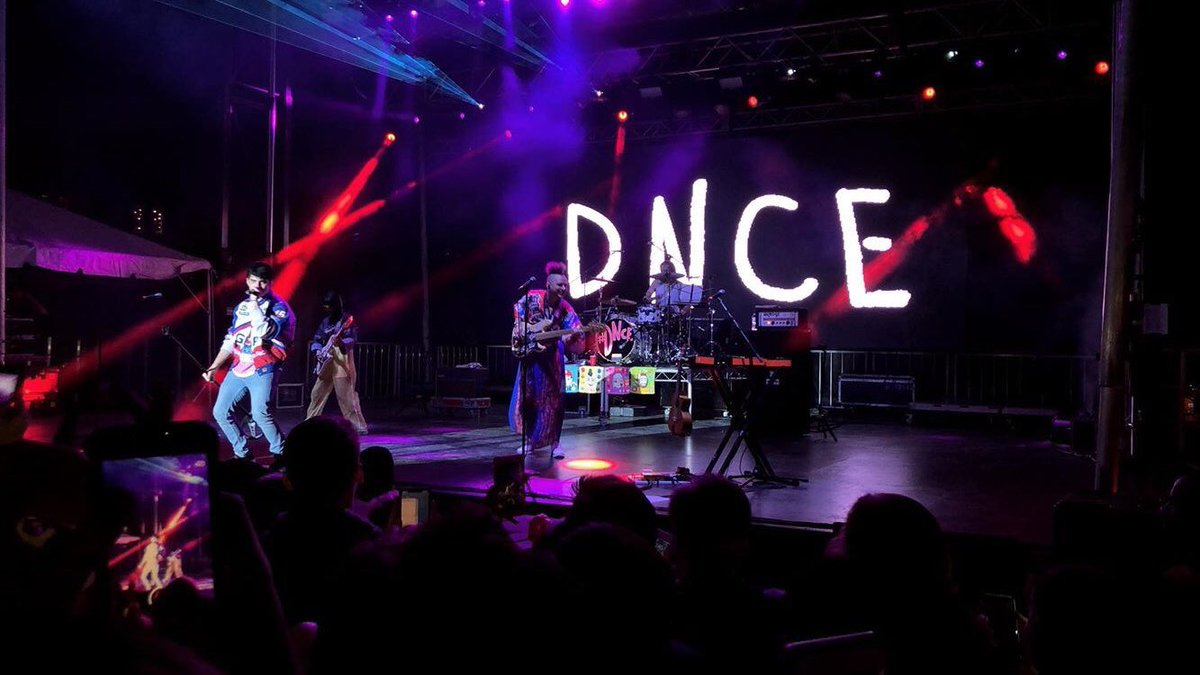 DNCE performing onstage at 2018 Rites of...